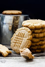 stock photo of shortbread  - shortbread cookie with peanut butter on a black background - JPG