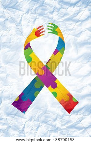 autism ribbon against crumpled white page
