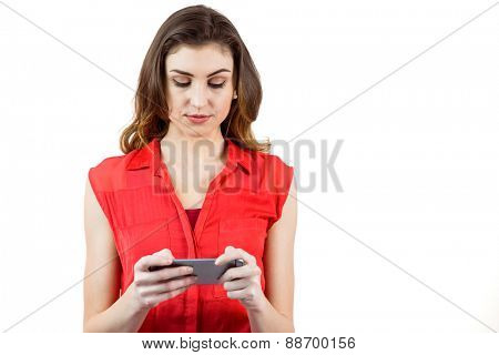 Pretty brunette sending a text on white background