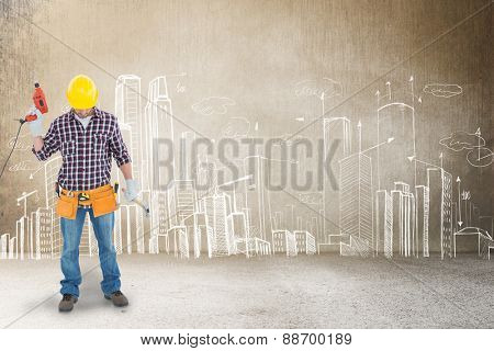 Male repairman holding drill machine and hammer against hand drawn city plan