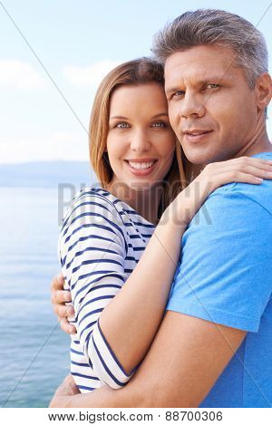 Amorous couple in embrace enjoying summer vacation