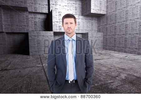 Businessman looking at the camera against abstract room