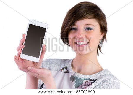 Pretty brunette showing her smartphone on white background