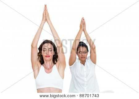 Relaxed women raising arms on white background