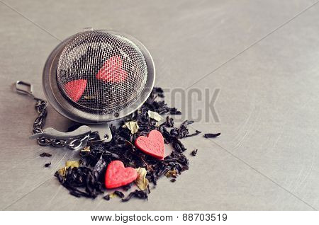 Tea On The Background Of The Strainer