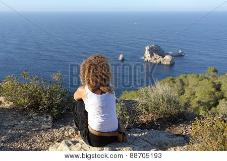 Woman Pensive Relaxing On A Cliff In Ibiza Island