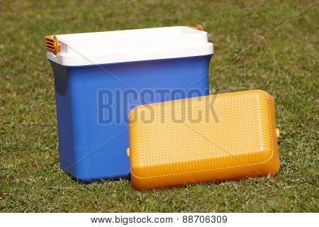 Picnic Cooler In The Grass In Blue And Orange Tone