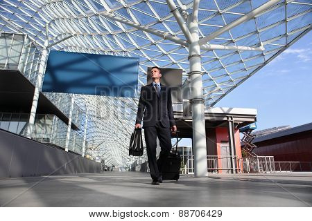 Business Man Travel Work Look The Sign Board Walking With Luggage Trolley