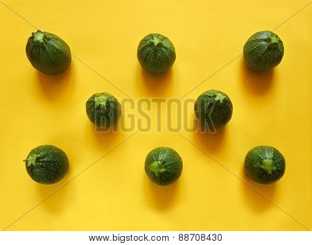 Round Zucchini On Yellow Background