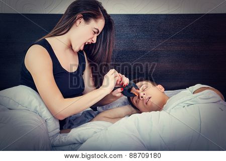Young Girl Being Angry On Snoring Boyfriend