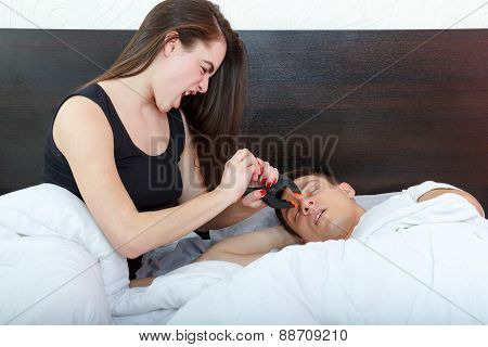 Unhappy Woman And Her Snoring Husband