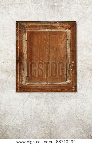 back of old wooden picture frame on old wall