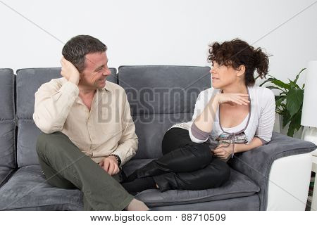 Nice Couple Relaxing On Sofa, Talking Together