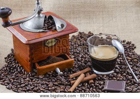 coffee, cup and grinder, assembly performed in studio