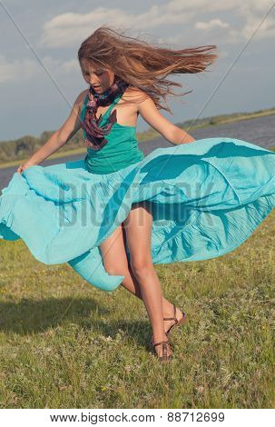 Cheerful Girl Spinning On Green Field, Summer