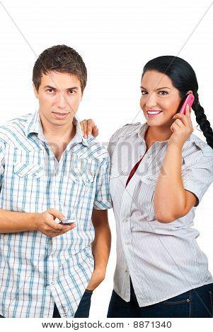 Happy Couple Using Phones Mobile