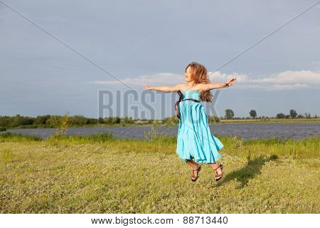 Funny Little Girl Jumping On Green Field, Summer