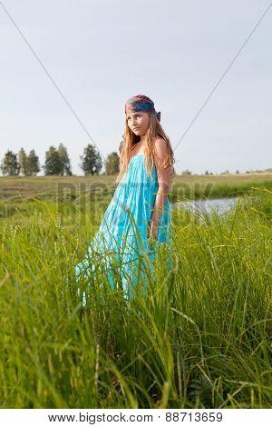 Beautiful Girl Stands On Green Field, Summer, Sunset