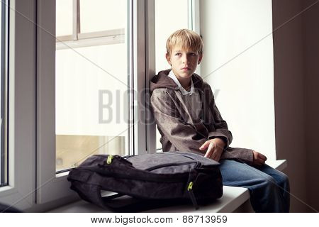 Pupil Sits At A Window