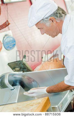 Butcher slicing ham