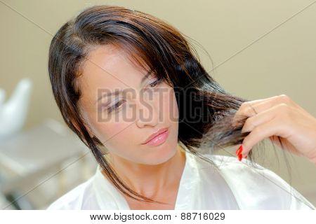Hairdresser cutting a woman's hair