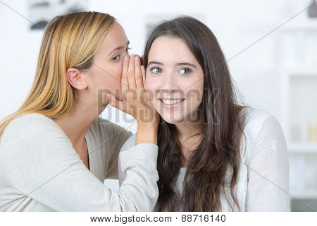 Whispering a secret to a friend