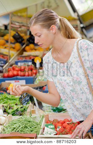 Blonde women at her local market