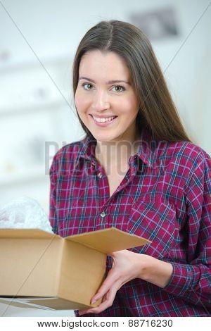 Woman holding a cardboard box
