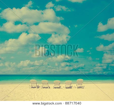 Concept photo of beach with chair in vintage toned.