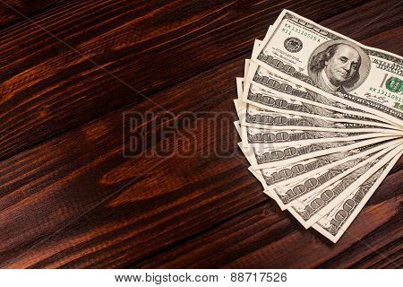 Dollars on wooden table