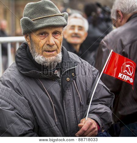MOSCOW, RUSSIA - MAY 1, 2013: During the celebration of May Day in the centre of Moscow. Communist party supporters take part in a rally marking the May Day.