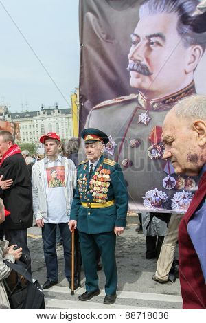 MOSCOW, RUSSIA - MAY 1, 2010: During the celebration of May Day. Communist party supporters take part in a rally. (portrait of Soviet dictator Josef Stalin)