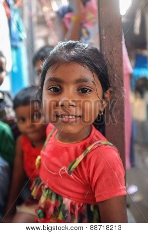 MUMBAI, INDIA - 08 JANUARY 2015: Young girl living in Dhobi ghat looking at camera
