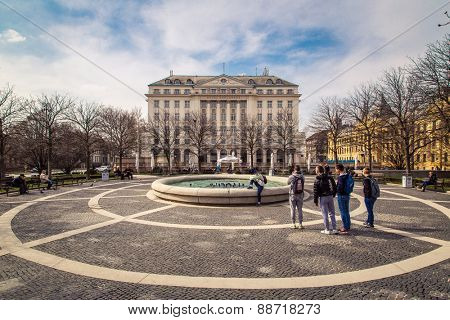 ZAGREB, CROATIA - 17 MARCH 2015: A side view of the main entrance to the Esplanade Hotel in Zagreb from a park with a fountain with school boys taking a picture.