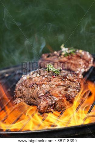 Beef steaks on grill