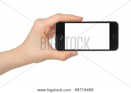 KIEV UKRAINE - MARCH 7 2015:Hand holds iPhone 5s Space Gray
