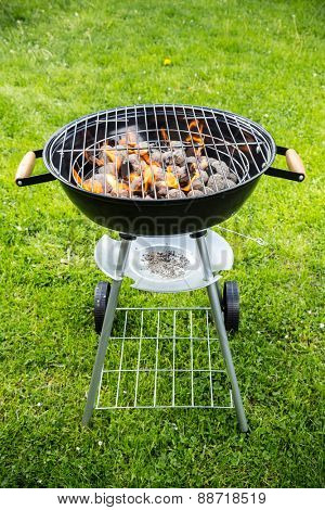 Empty grill with fire on garden