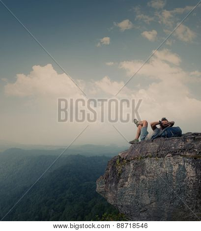 Hiker relaxing on top of the mountain