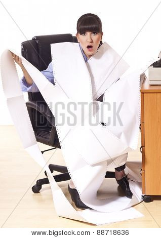 Business woman with lot of paper work, tired and frustrated