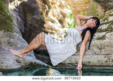 Girl enjoying by pure water
