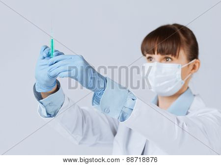 close up of female doctor holding syringe with injection