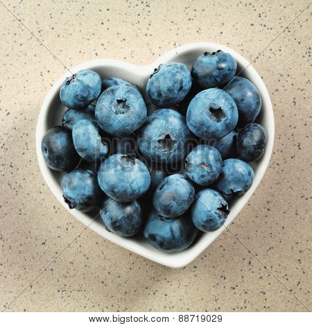 Blueberry in heart shaped bowl