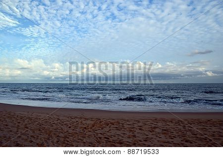 Sand Beach And Blue Sky By The Sea On Sunset