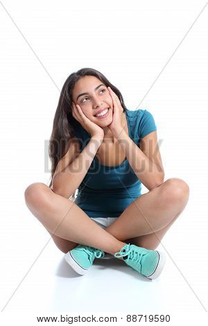 Teenager Girl Sitting And Thinking Looking Sideways