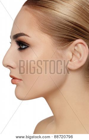 Profile portrait of young beautiful woman over white background