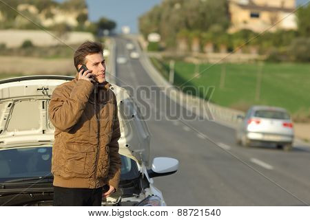 Happy Man Calling Roadside Assistance For His Breakdown Car