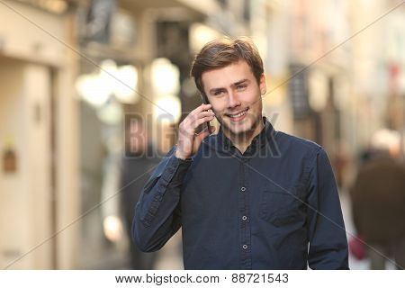 Man Calling On The Phone Walking On The Street