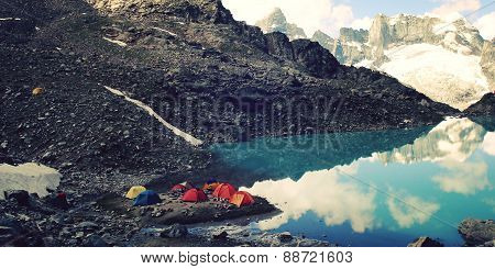 Campground Near Alpine Lake  Vintage Effect. Colorful Tents. Caucasus Mountains.