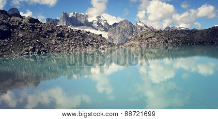 Dolomite Lake At Uzunkol, Caucasus Mountains. Bright Blue Alpine Lake.