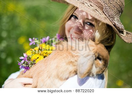teenager girl with bunny in the nature